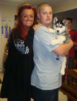 Hudson's Malamutes - Wynona Judd with A Hudsons puppy.